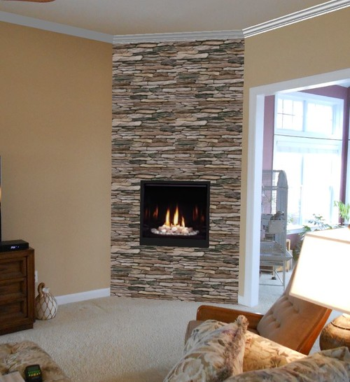 we used a 32 direct vent fireplace vented up through the roof with a stacked stone veneer that anchors the room - Fireplace With Stone Veneer