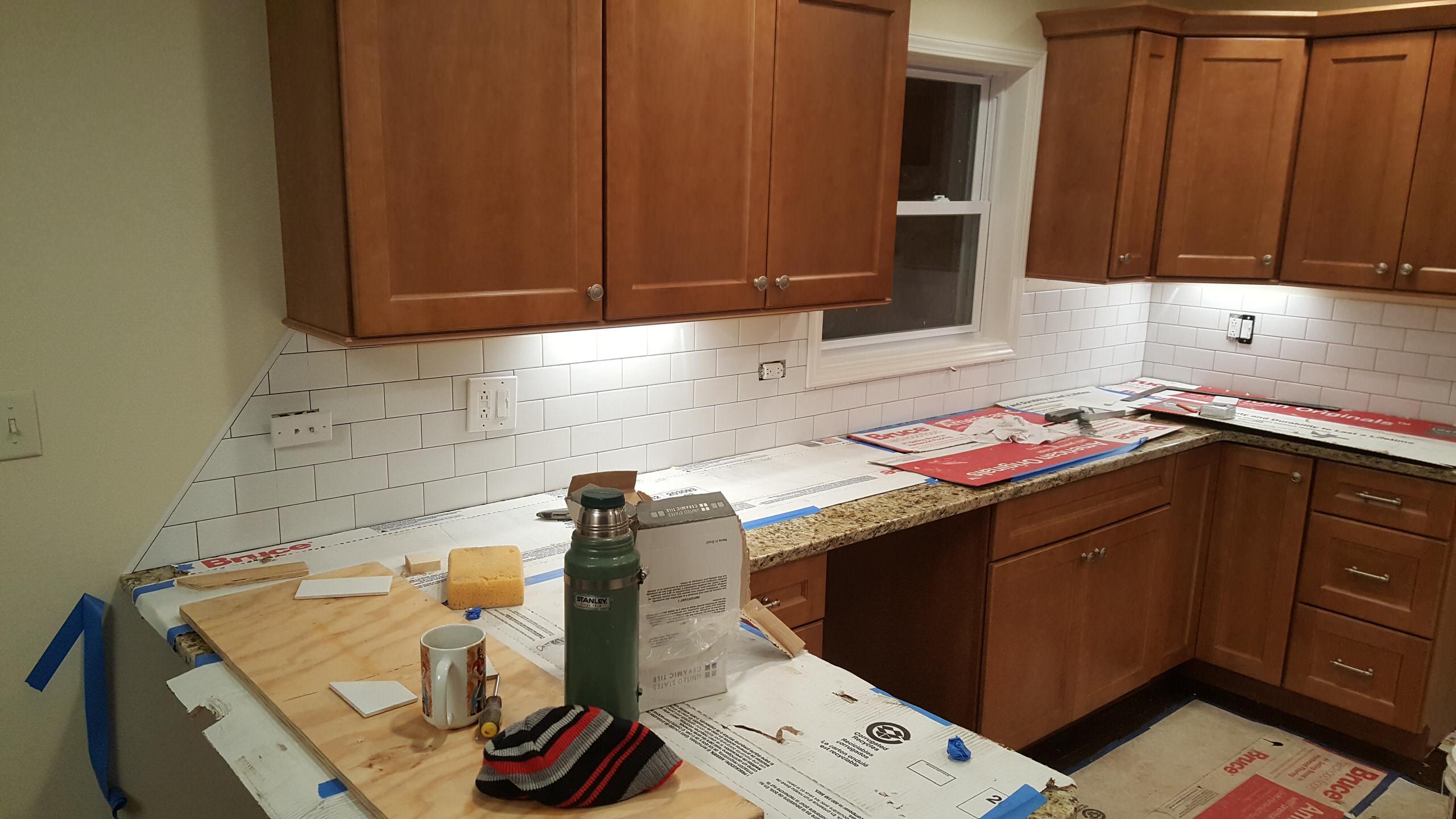 Installing a subway tile backsplash in a new kitchen