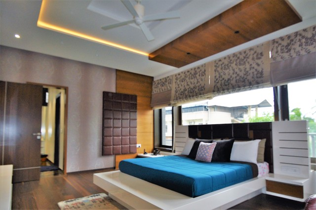 Example of a trendy bedroom design in Bengaluru
