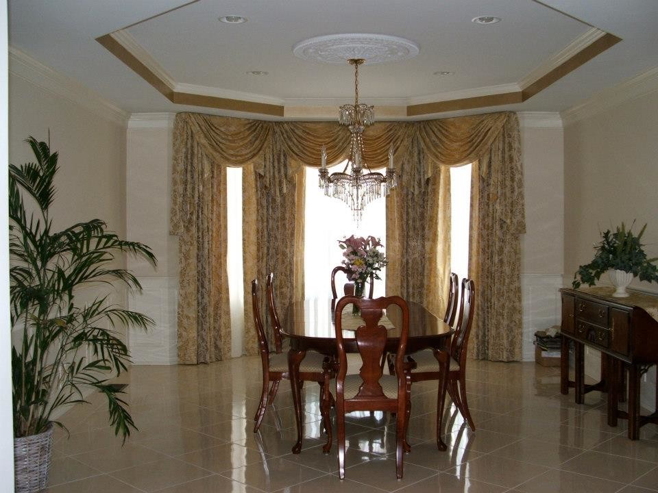 Ceilings. Gold trim on tray ceiling in dining room