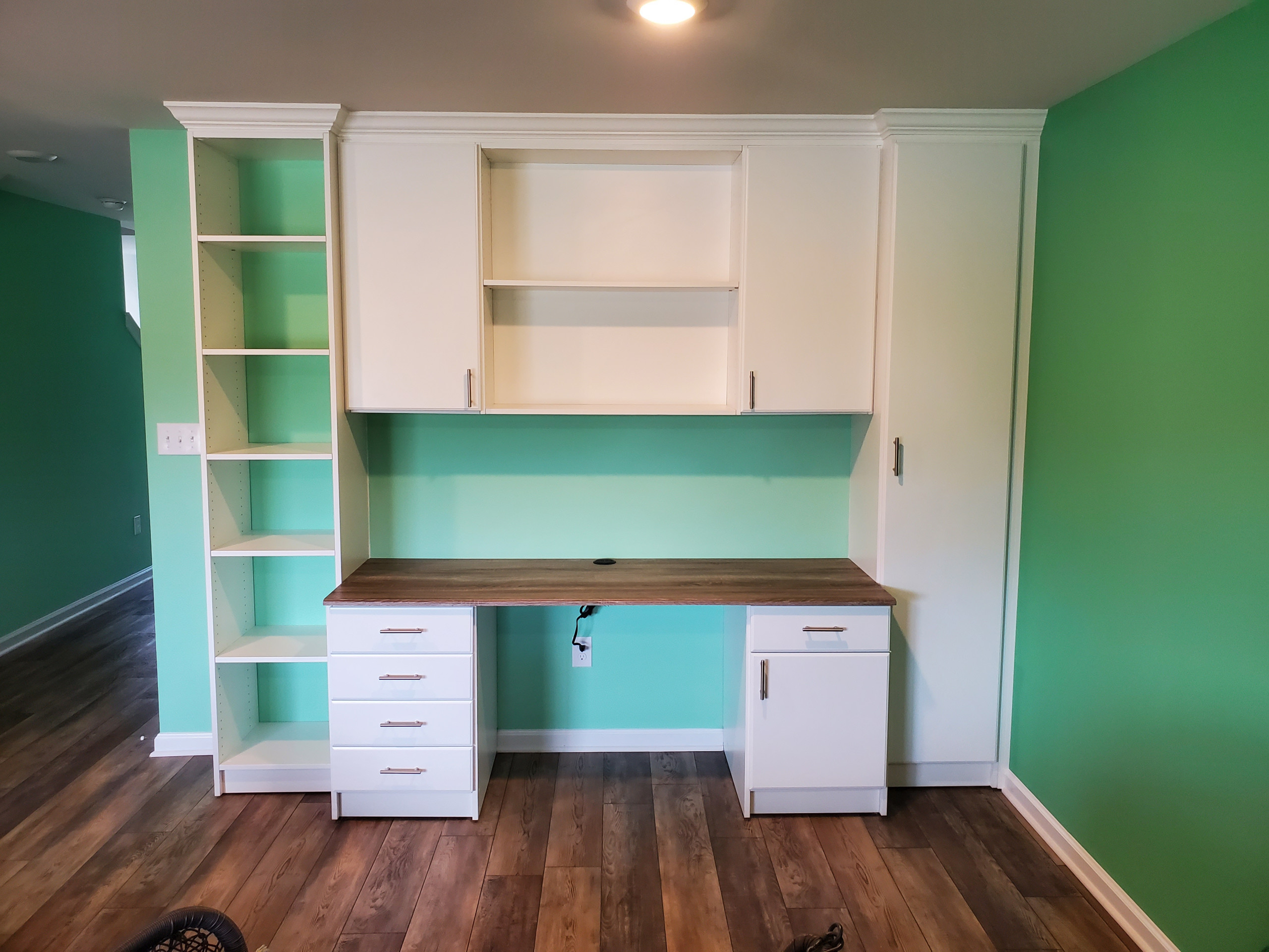 Wall desk in a family room.  Needed more space due to Covid.