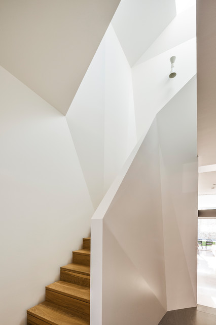 Photo of a large modern wood l-shaped staircase in Sydney.