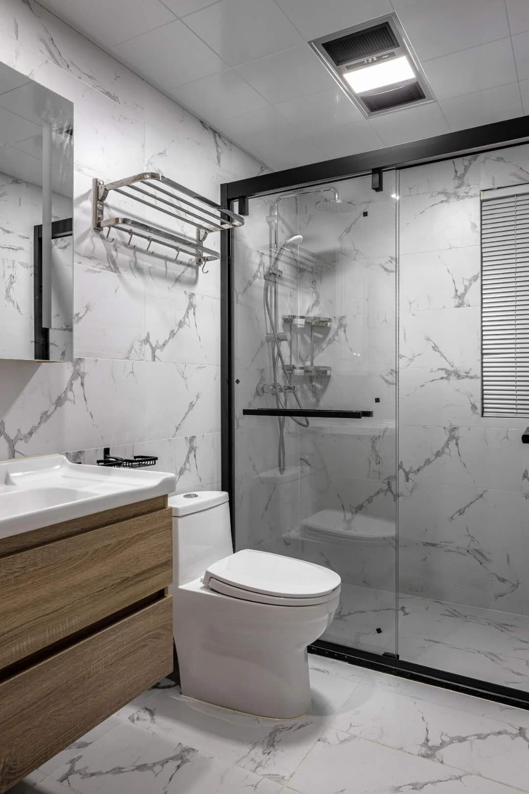Same tile wall and floor style with shower glass partition
