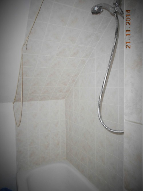 How to fit a shower rod in attic bathroom with sloped ceilings
