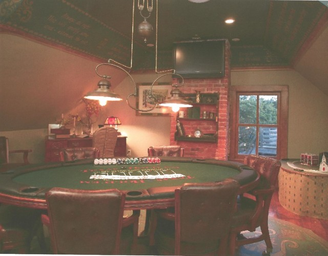 Example of a small classic enclosed medium tone wood floor game room design in Philadelphia with beige walls and a wall-mounted tv
