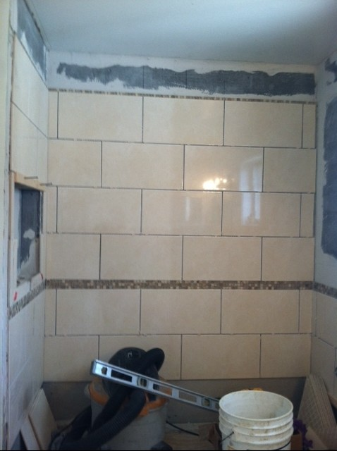 tile guy put decorate strip higher then shower curtain height - Bathroom Tiles Height