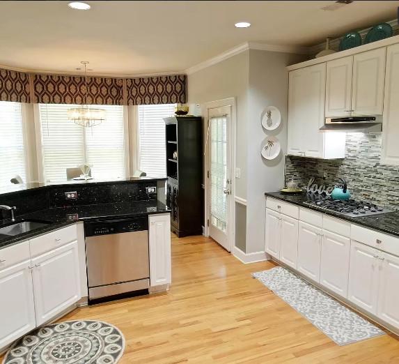 Traditional white hardwood cabinets