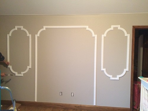wallpapering in picture frame molding