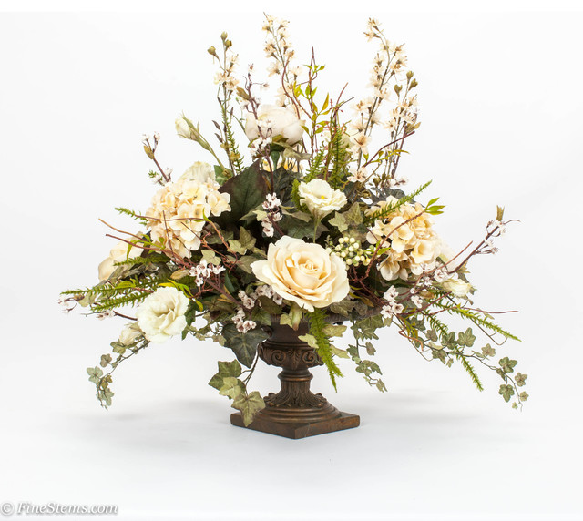 Cream Centerpiece Silk Floral Arrangement Placed In A Bronze Urn Traditional