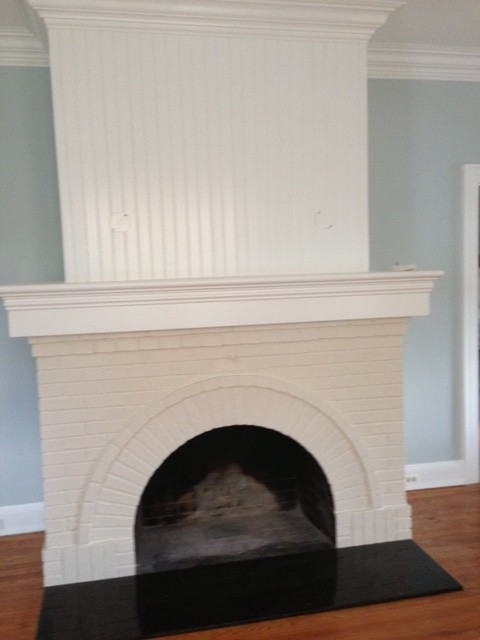 I need an opinion on what shape fireplace screen to use with fireplace. We will install gas logs but the fireplace is level with the floor. It