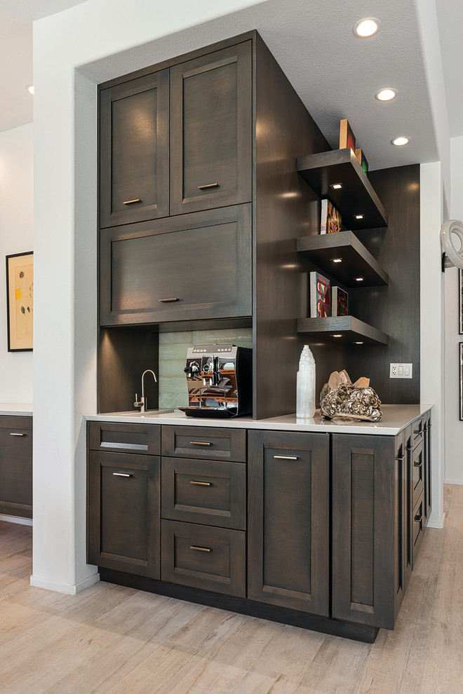 Example of a transitional kitchen design in Seattle with shaker cabinets and dark wood cabinets