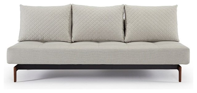 Supremax Quilt Deluxe Sofa Bed, Dark Styletto Legs, White Leather Look.