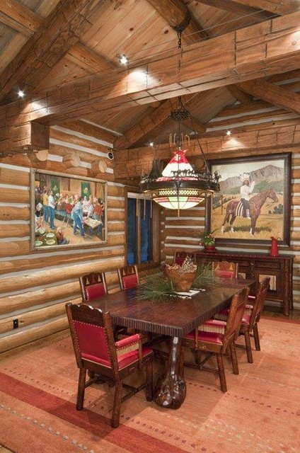 Example of a mountain style dining room design in Other