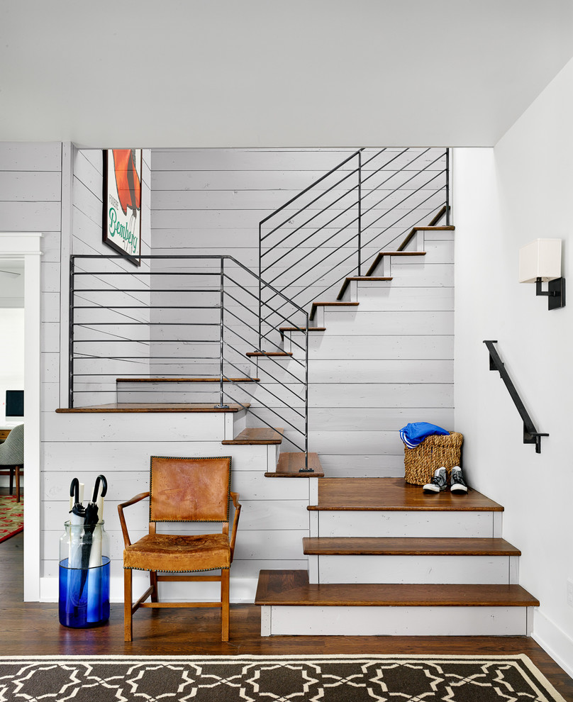 Staircase - country wooden u-shaped staircase idea in Austin