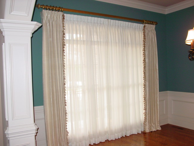pinch pleated draperies over sheer panels traditional