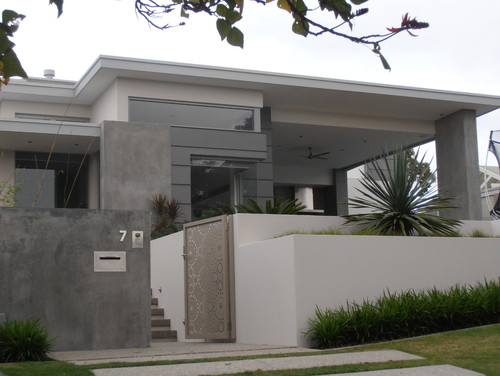 are the dark grey walls concrete or rendered in a concrete