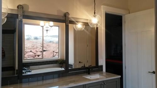 Mirror On A Barn Door Track With A Hidden Medicine Hutch