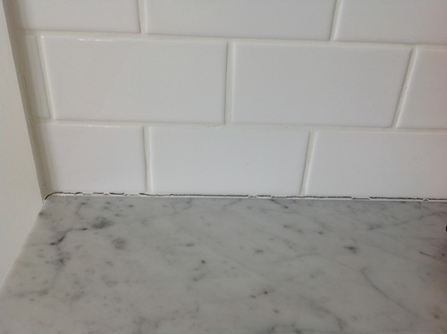 Cracking Grout Silicon Along Walls In Kitchen Where Tile