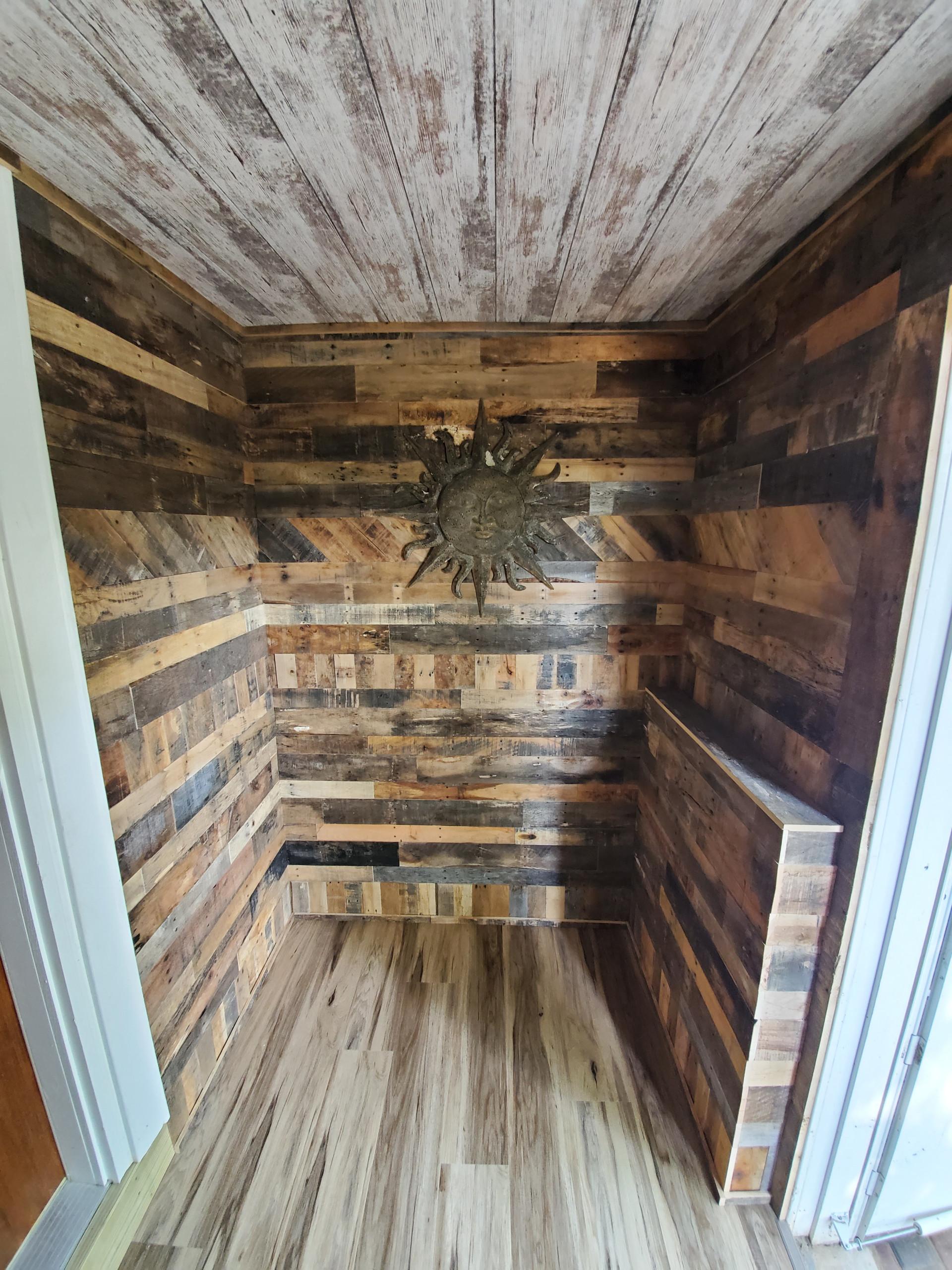 Creative barn wood entry remodel
