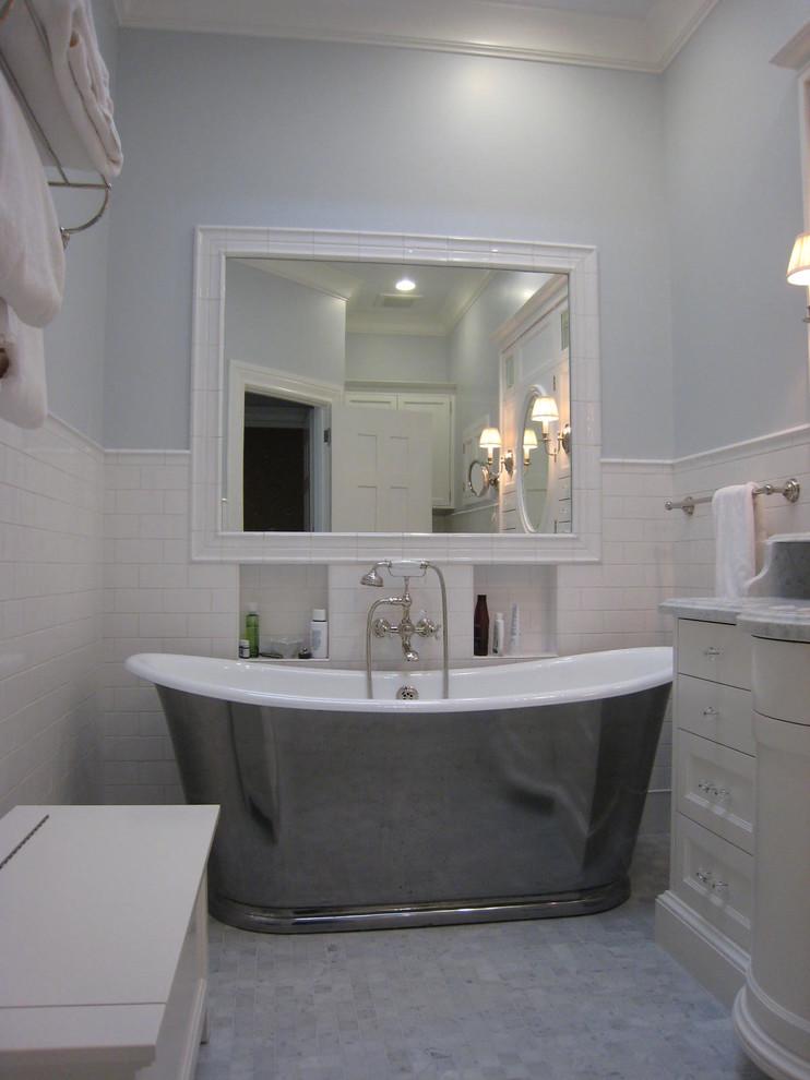 Free standing tub in very light bathroom