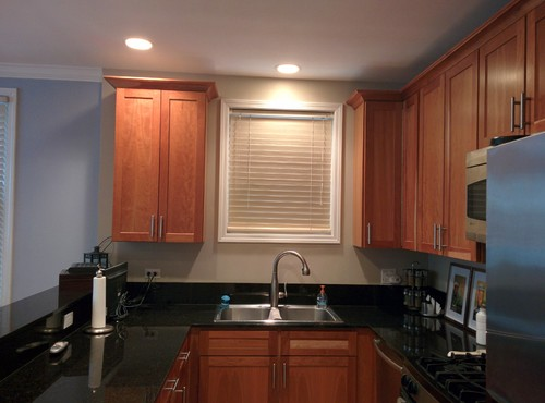 How to backsplash with uneven cabinets?