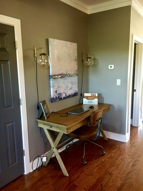 Inspiration for a mid-sized industrial freestanding desk medium tone wood floor and brown floor home office remodel in Charlotte with gray walls