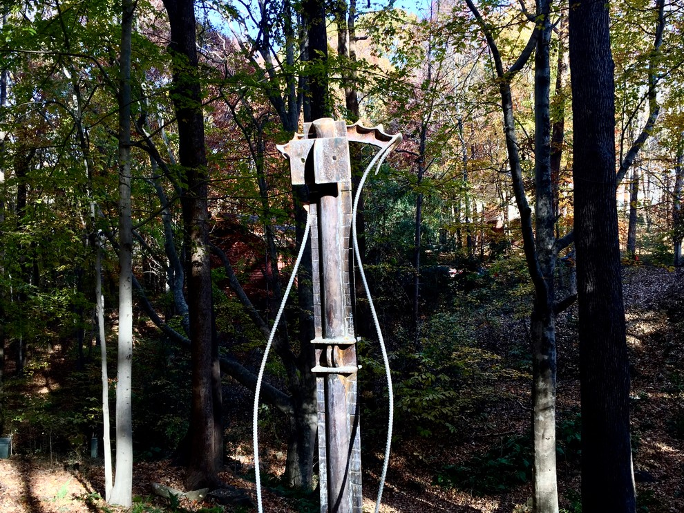 Industrial sculpture blends with the forest