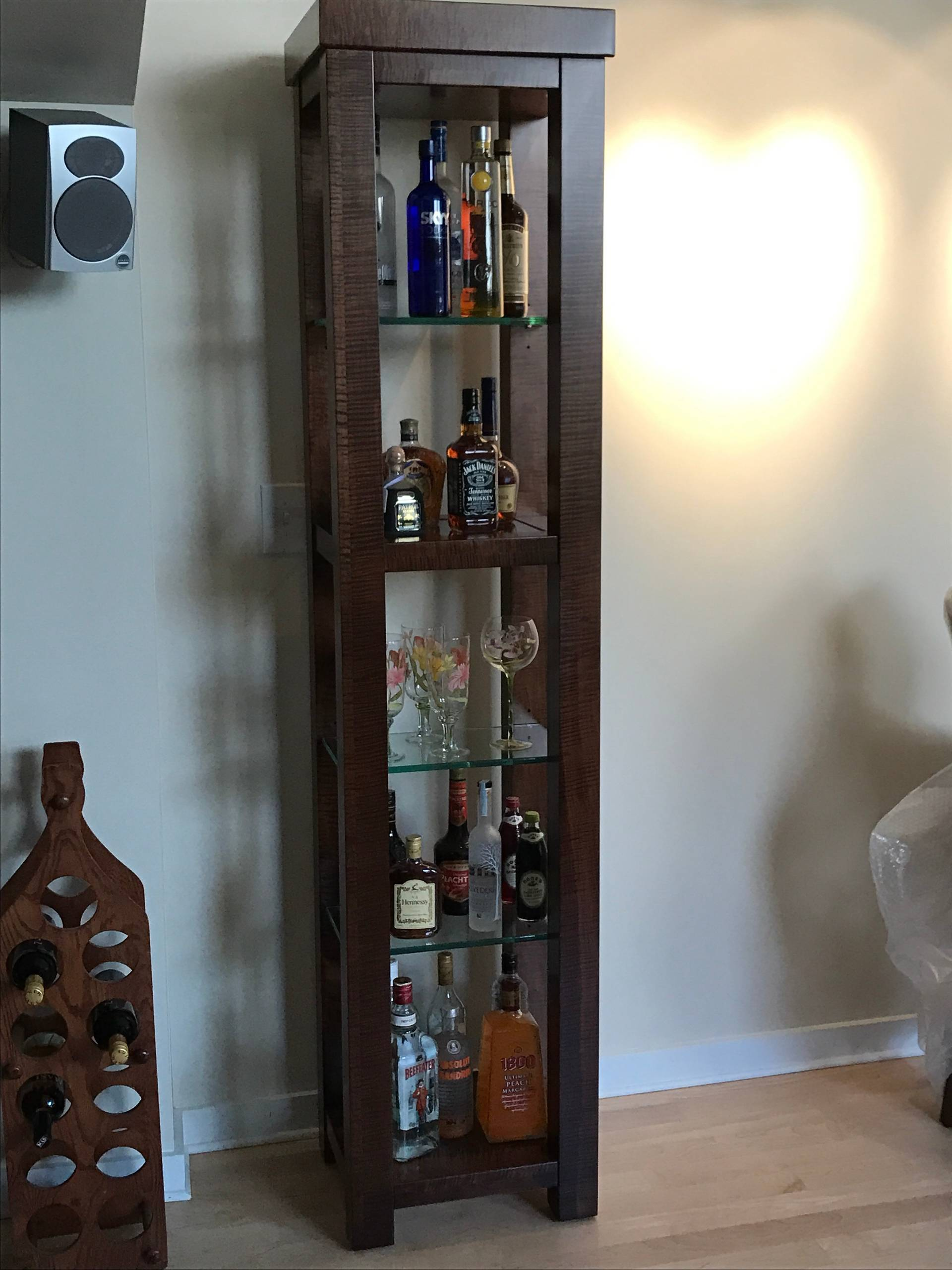 Custom built and designed bar cabinet in Tiger Maple with glass inlay and glass