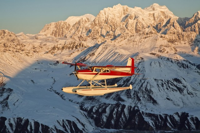View Of A Cessna 185 Floatplane In Alaska Range Over Ruth Glacier At Sunset  Sou