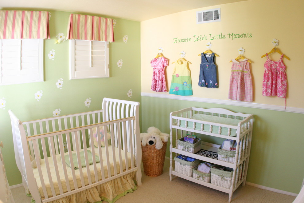 Example of a mid-sized classic girl carpeted and beige floor nursery design in Other with multicolored walls