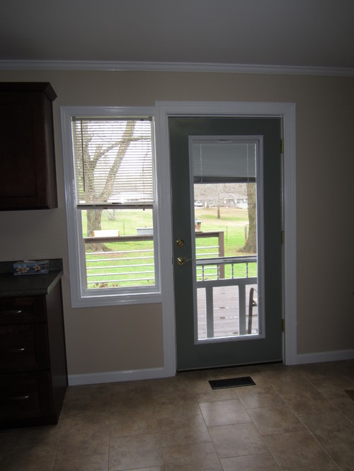Note height from ceiling wall cabinets and door to open freely. I would also like to have the curtains over the sink match. See attached images & Kitchen curtains for adjacent window and deck door.