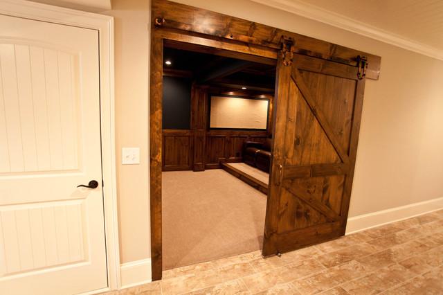 Sliding theater room barn door for Sliding barn door living room