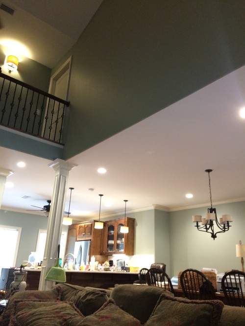 How to decorate the walls in a 2 story living room for 2 story living room decorating ideas