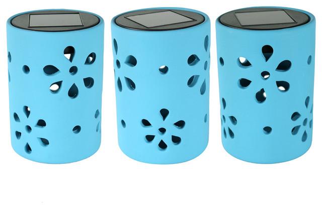 Sunnydaze Blue Ceramic Jar Style Solar Light With Flower Cutouts.