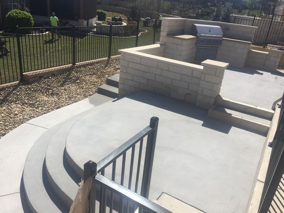 New multi-leveled concrete patio w/ limestone walls and outdoor kitchen