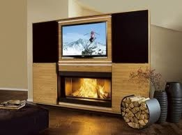 flat screen tv over a working fireplace. Black Bedroom Furniture Sets. Home Design Ideas