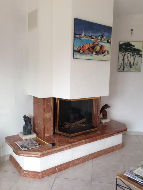 relooker une cheminee en pierre maison design. Black Bedroom Furniture Sets. Home Design Ideas