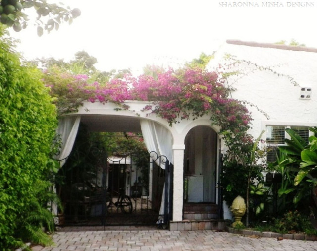 Classic white mediterranean home with bougainvillea over for Classic mediterranean house