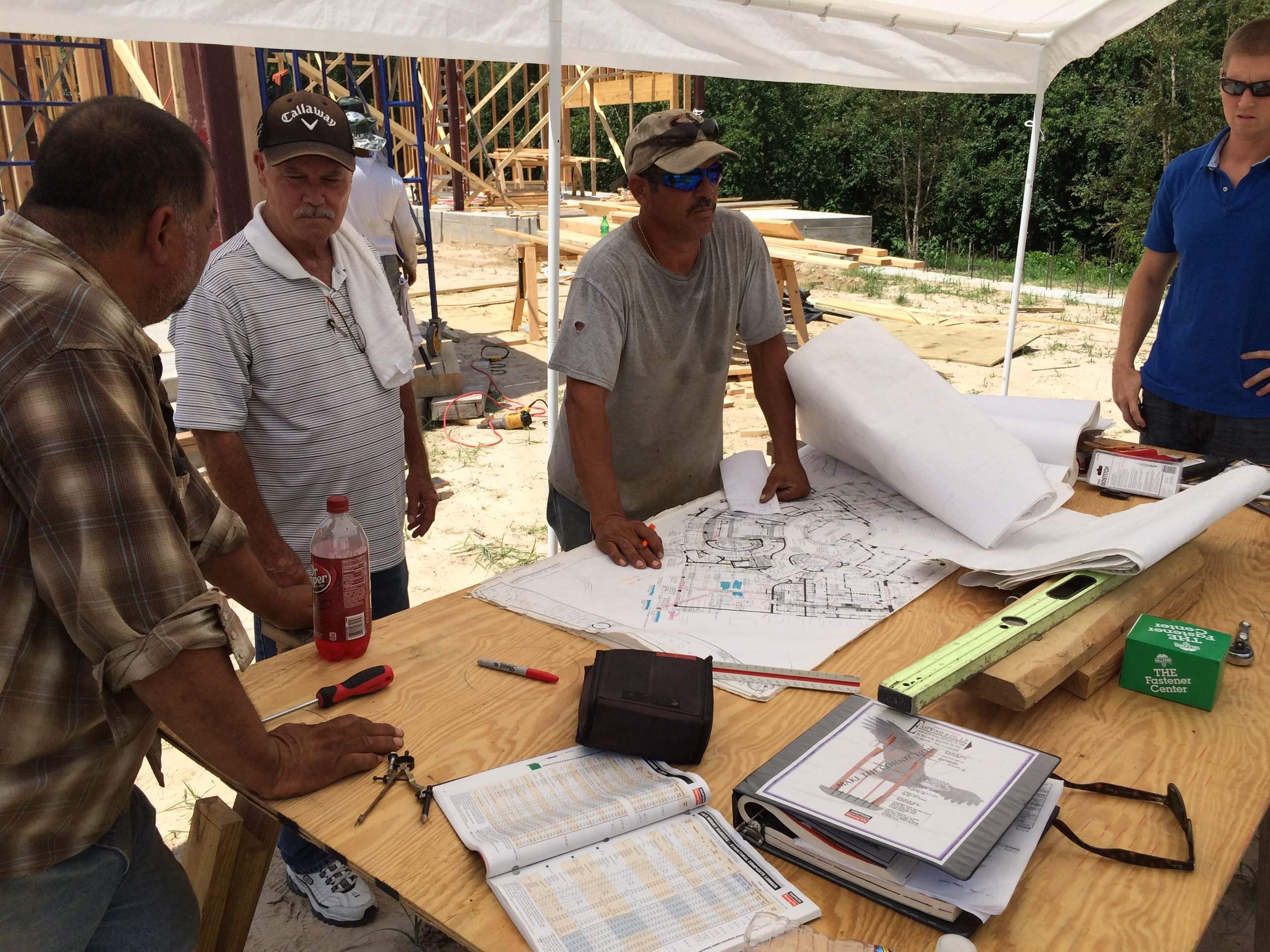 Job site meeting between project manager & steel contractor.