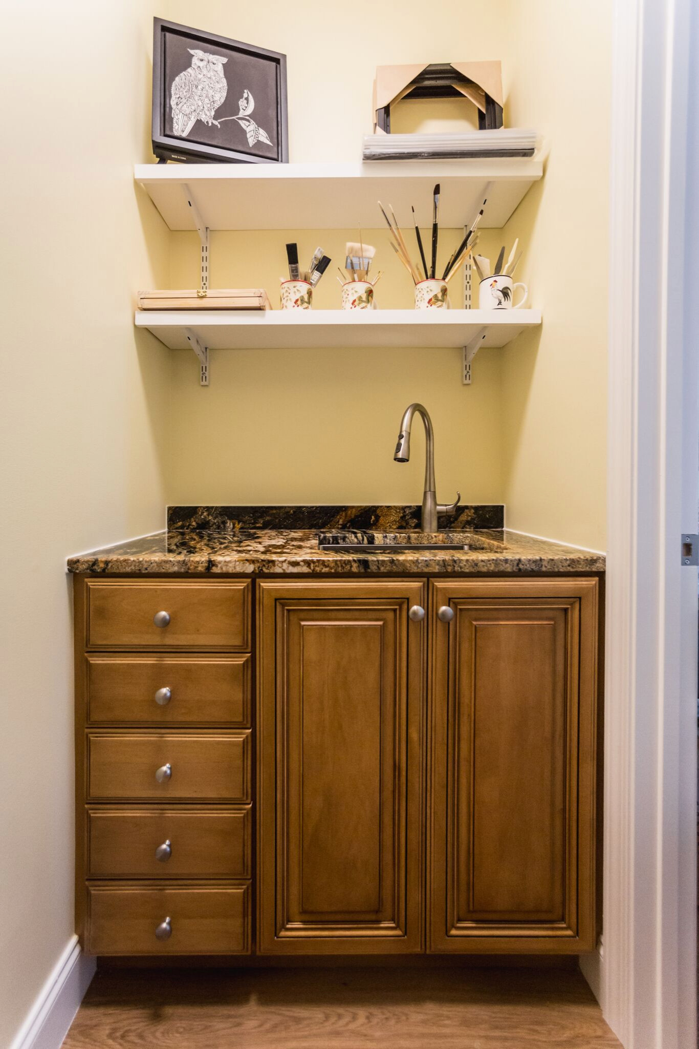 Shallow drawers for art supplies, sink to wash them!