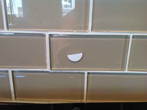 Scratched glass backsplash what should we do for Back painted glass tile