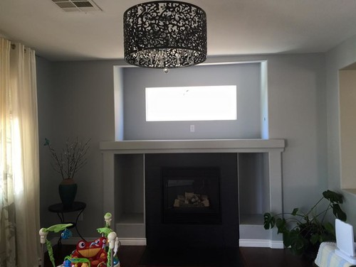 almost four years I rant about this room and ugly fireplace niche / window. I am really thinking into  wall that window and place a tv above the fireplace !  should I go for it ? do you thing it will be better than what it is now ?   many of my friends suggested to do the tv thing  I just want to ma...