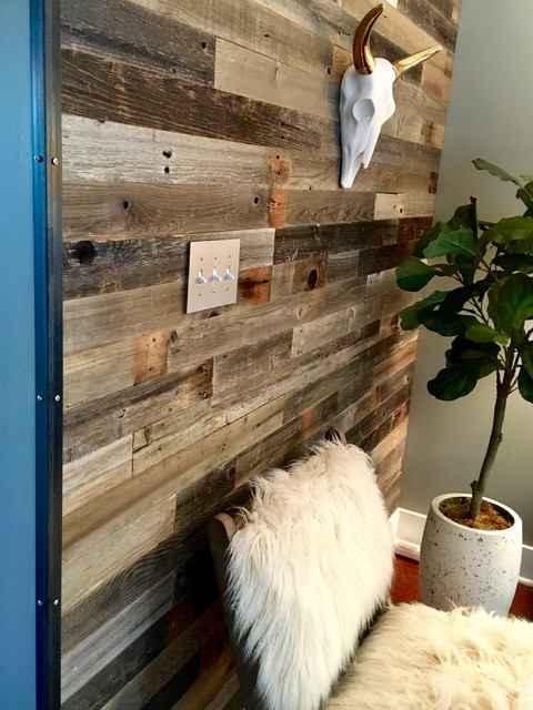 Inspiration for a mid-sized industrial medium tone wood floor and brown floor hallway remodel in Charlotte with green walls