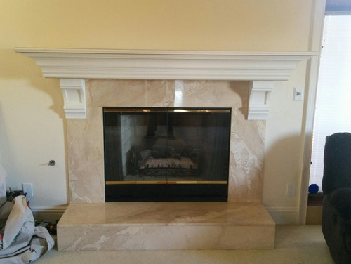 We added the mantel and corbels to this fireplace.  We debated where to put the corbels. I don