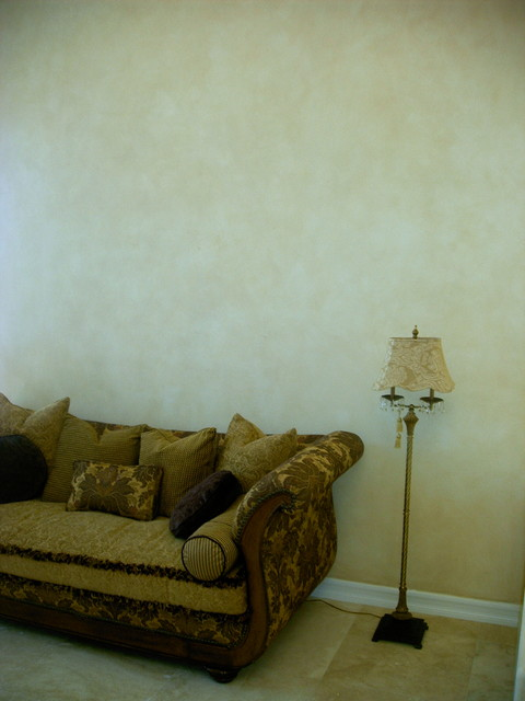 Great room - mid-sized mediterranean great room idea in Orange County with beige walls