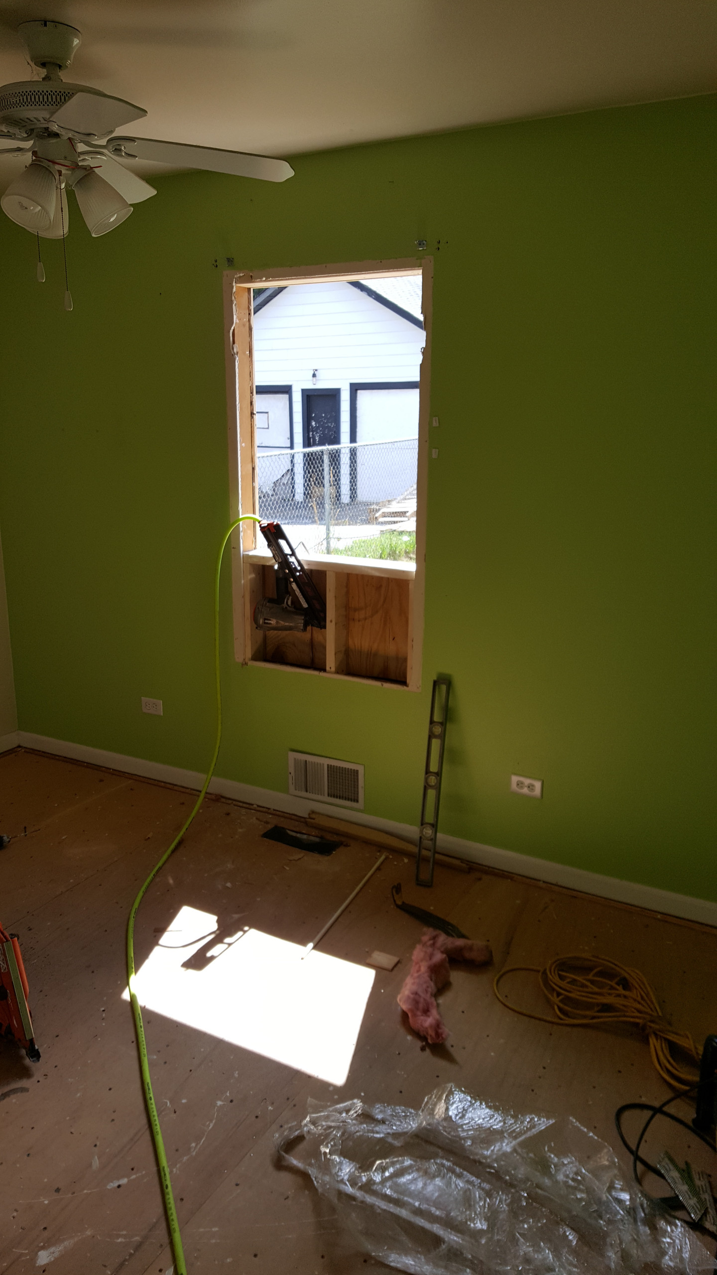 Modifying window sizes...this small bedroom will be the new laundry/utility room