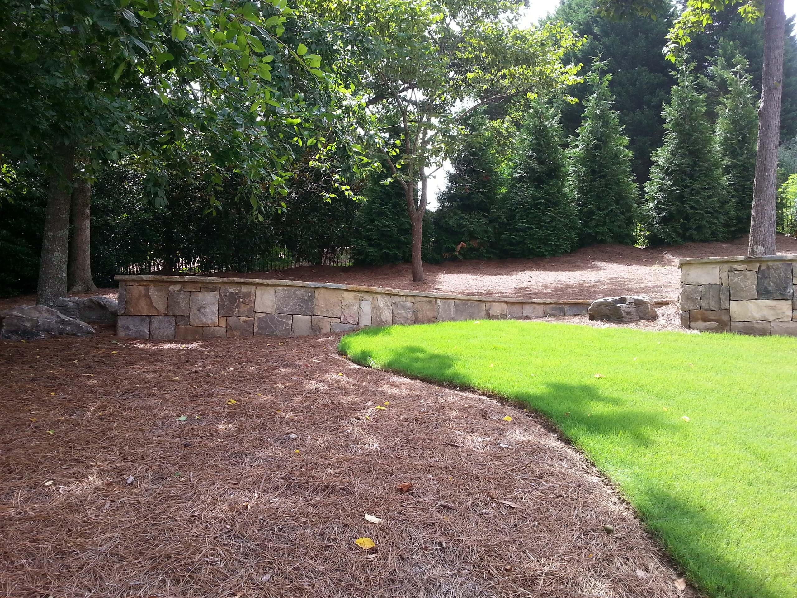 Multi-level stone retaining walls