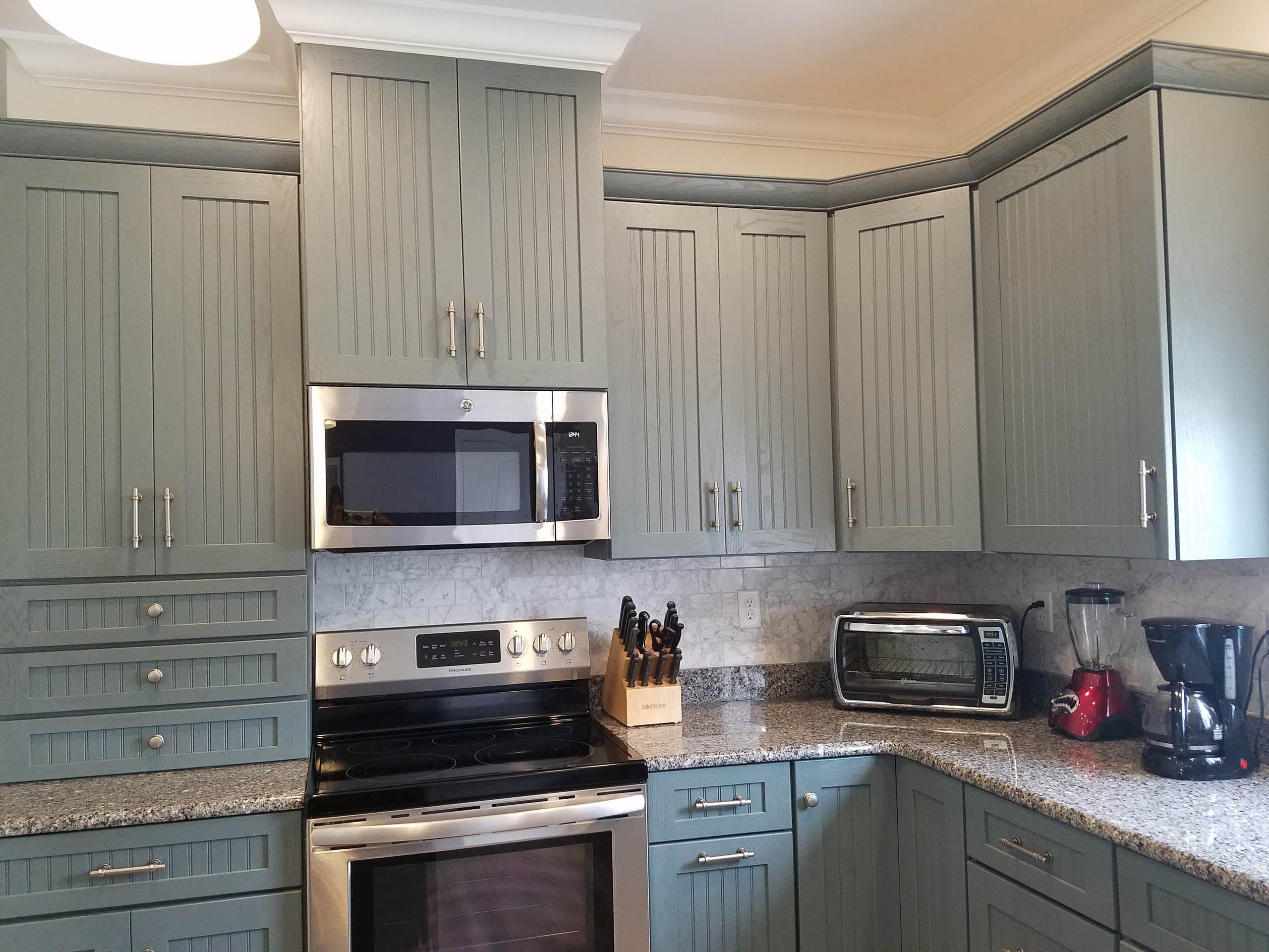 Medallion Cabinetry, Oak with Islander painted finish