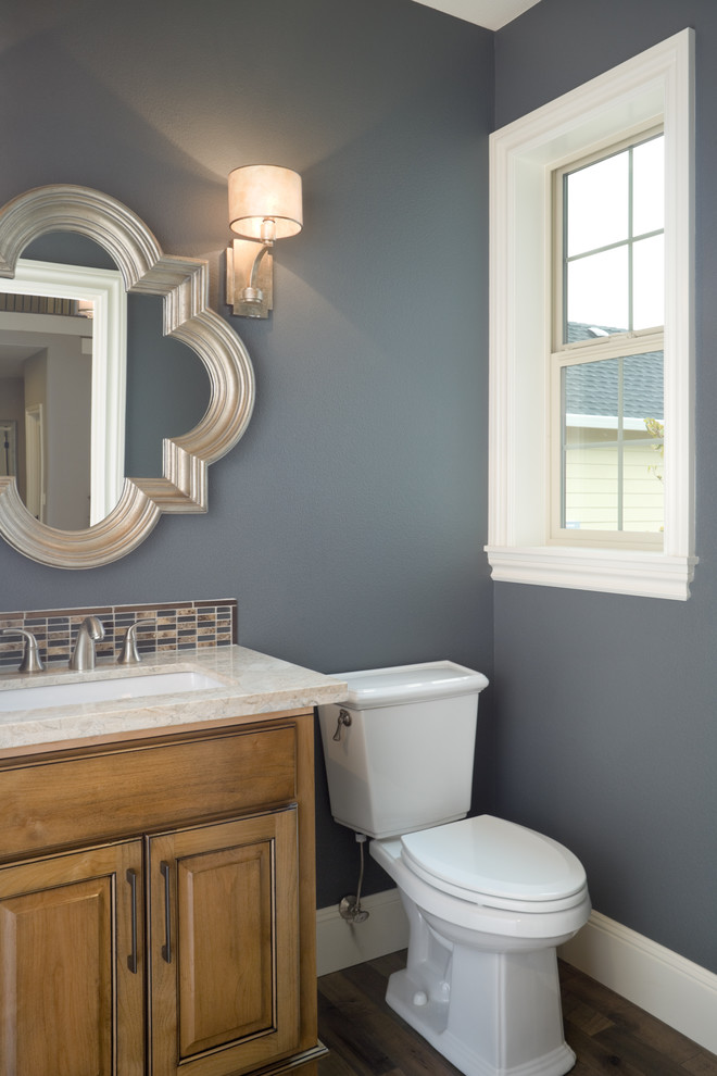 Bathroom - traditional multicolored tile and mosaic tile bathroom idea in Portland with an undermount sink, raised-panel cabinets, medium tone wood cabinets and a two-piece toilet