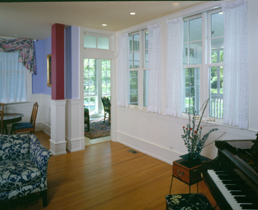Inspiration for a large transitional open concept medium tone wood floor living room remodel in Chicago with white walls and a standard fireplace